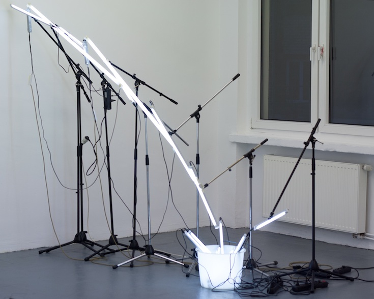 Albert Mayr, w. t. (lightinstallation), 2015, 8 mic stands, 15 neon tubes, bucket, cables, ca. 240 x 215 cm, 2015